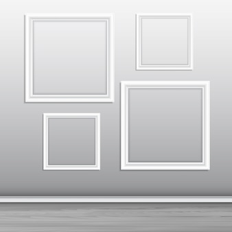 Collection of blank picture frames hanging on a wall