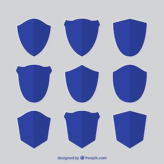 Raccolta di scudi blu in design piatto