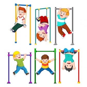 Collection of boy is hanging on the monkey bar