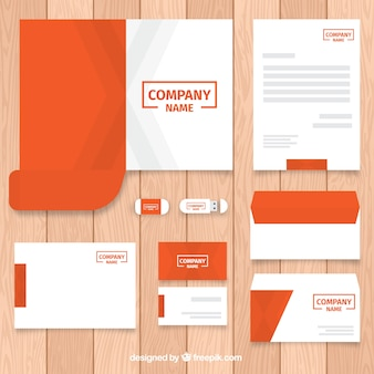 Collection of business stationery template in orange color Premium Vector