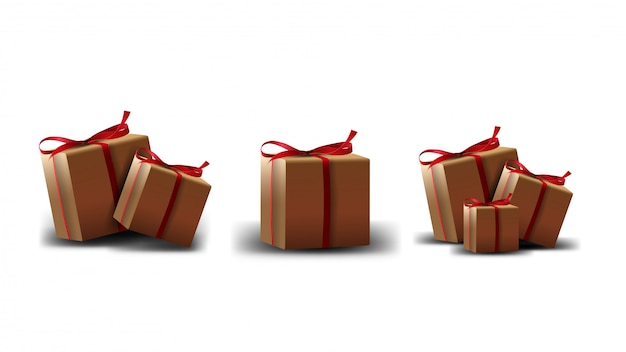 A collection of cardboard gift boxes with red ribbon isolated