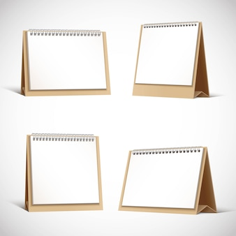 Collection of cardboard table planners or calendars.