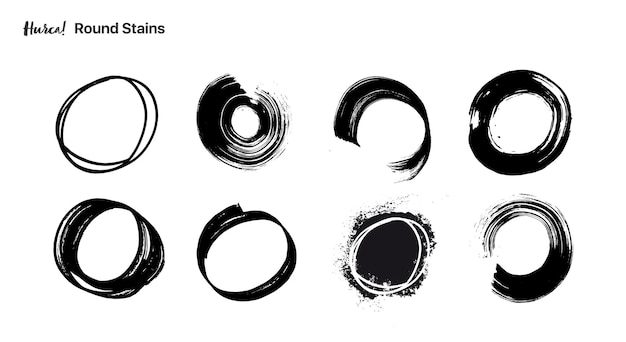 Collection of circular black paint strokes made with dry brush