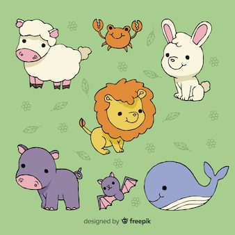 Collection of cute animals on green background