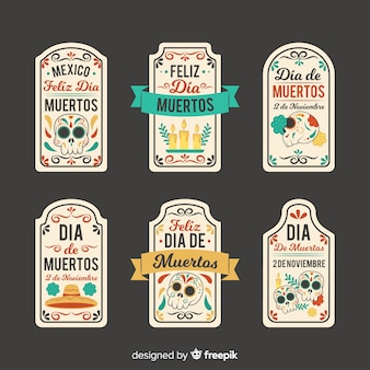 Collection of dia de muertos label on flat design