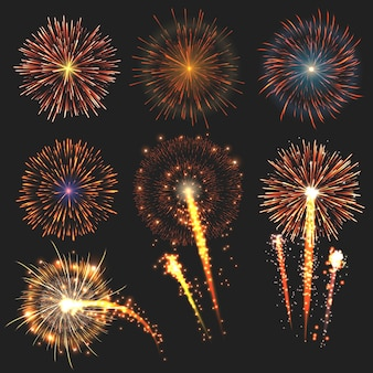 Коллекция праздничных фейерверков различных цветов на черном