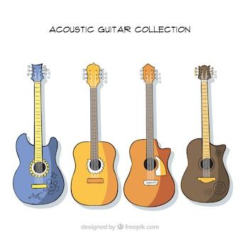 Collezione di quattro chitarre acustiche con disegni diversi