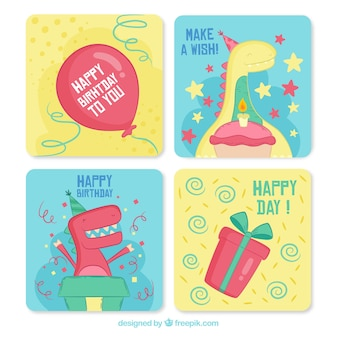 Collection of four hand drawn birthday cards with dinos
