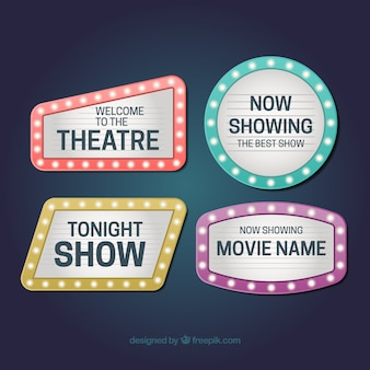 Collection of four shiny signs for theaters