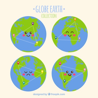 Collection of four smiling earth globes