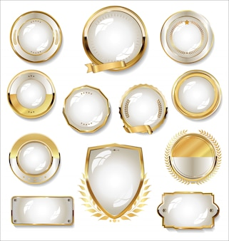 Collection of gold and white badge and labels