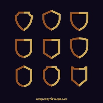 Collection of golden shields in flat design