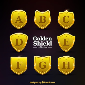 Collection of golden shields with capital letters
