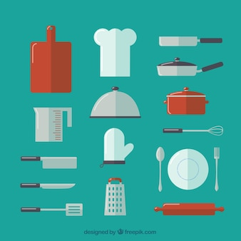 Raccolta di utensili da cucina e cappello da cuoco