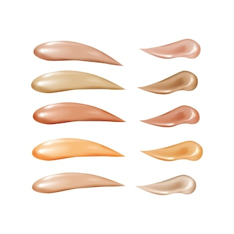 Collection of liquid foundation, cosmetic concealer smear strokes.