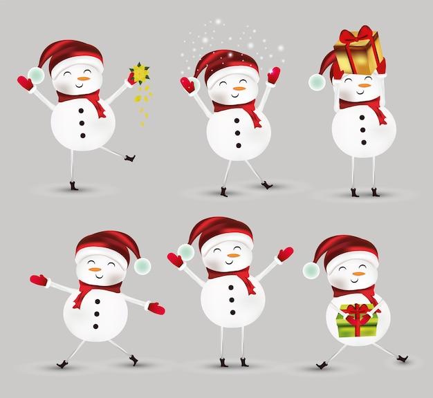 모자, 스카프 및 장갑을 착용하는 작은 크리스마스 눈사람 컬렉션.