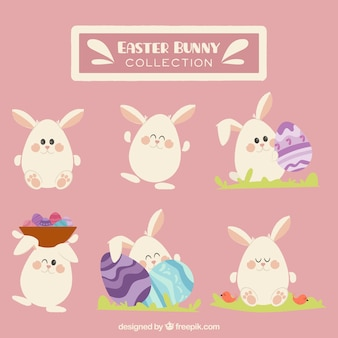 Collection of lovely easter bunnies Free Vector