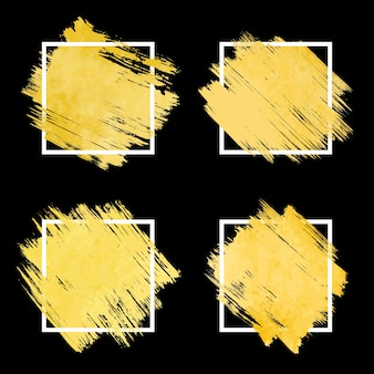 白い境界線を持つ抽象的な金色のブラシストロークフレームのコレクション。