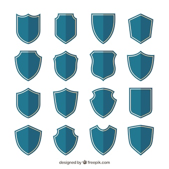 Collection of blue shields in flat design