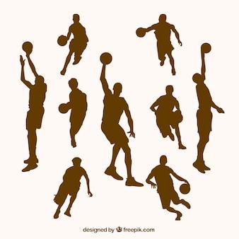 Коллекция коричневых силуэтов баскетболистов
