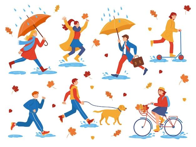 秋の日に歩くフラットな人々のキャラクターのコレクション。秋の屋外。公園の人々は犬と一緒に歩いたり、自転車やスクーターに乗ったり、水たまりを飛び越えたり、走ったりします。