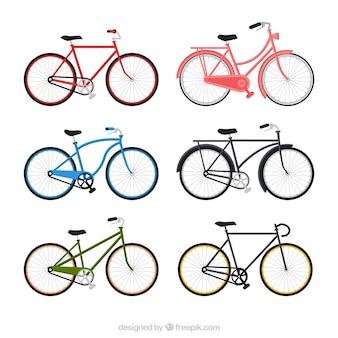 Коллекция красочных велосипедов в плоском дизайне
