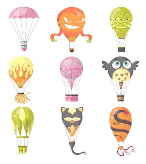 Коллекция различных романтических типов, мультяшных животных и горящих красочных летающих развлекательных фестивальных воздушных шаров на открытом воздухе.