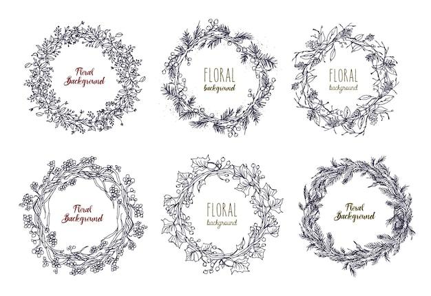 얽힌 꽃, 가지, 잎으로 만든 우아한 손으로 그린 화환 또는 원형 화환의 컬렉션입니다. 장식 꽃 요소 흰색 배경에 고립입니다. 흑백 벡터 일러스트 레이 션.