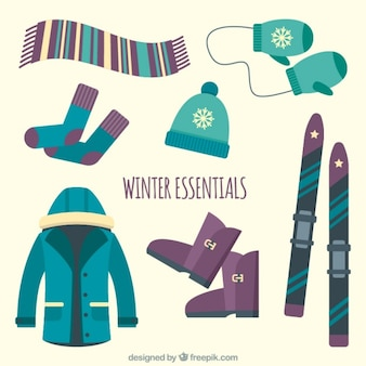 Collection of essential winter clothing and skis