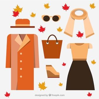 オレンジ色のトーンでの女性の服のコレクション