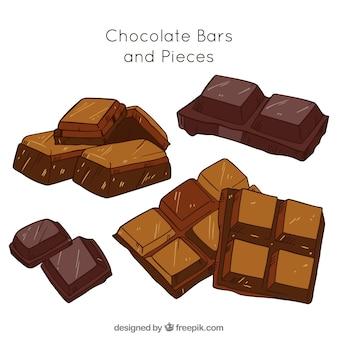 5つの手で描かれたチョコレートバーのコレクション