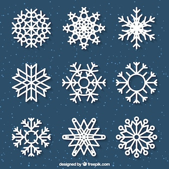 Коллекция плоских снежинок Бесплатные векторы