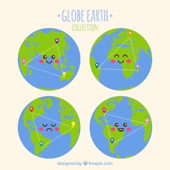Коллекция из четырех улыбающихся земных шаров