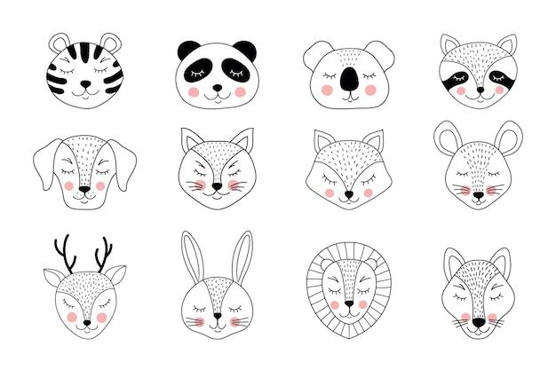 白い背景の上の手描きの動物のコレクション。