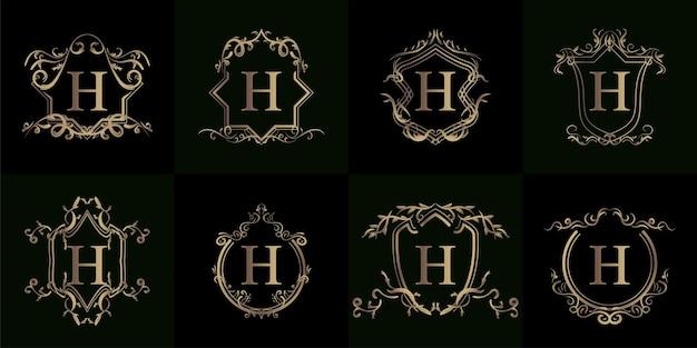 豪華な飾りや花のフレームとロゴのイニシャルhのコレクション