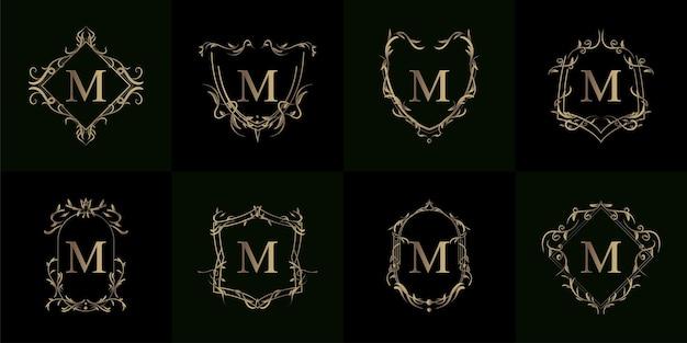 豪華な飾りやフラワーフレームのロゴイニシャルmのコレクション