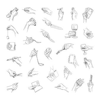 스케치 스타일의 다른 개체가 있는 손의 흑백 삽화 모음