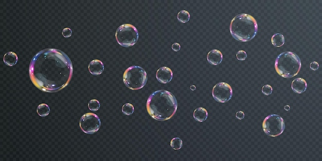 Коллекция реалистичных мыльных пузырей, пузыри расположены на прозрачном фоне.