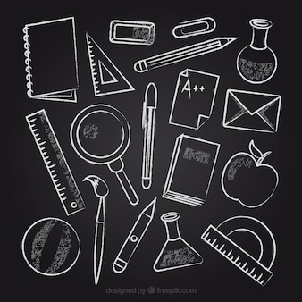 Collection of school elements on chalkboard