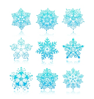 Коллекция силуэтов снежинок