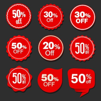 Collection of red sale stickers and tags