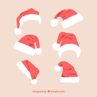 Collection of santa claus hats Free Vector
