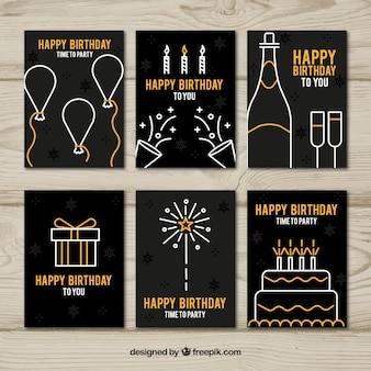 Collection of six birthday cards in black and golden