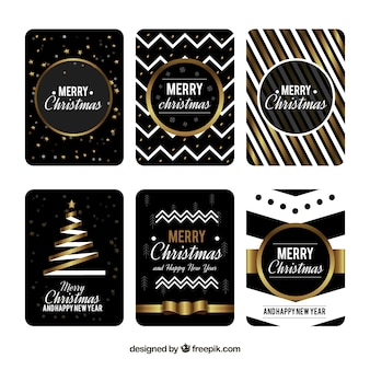 Collection of six christmas cards in black with golden and white elements