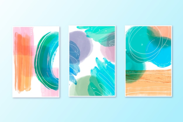 Collection of watercolor covers in blue and orange shades