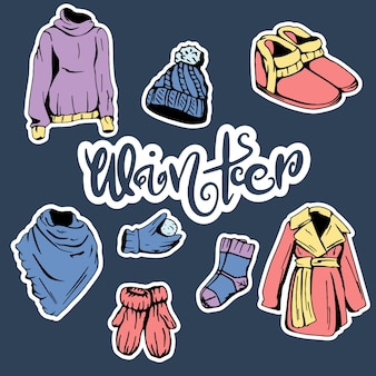 Collection of winter clothes. collection of clothes for winter. in a cartoon style.