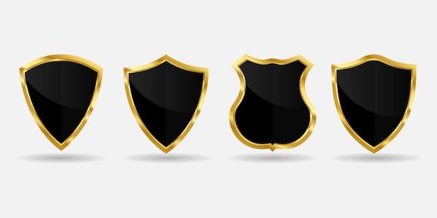 白い背景の上の金黒の盾のコレクション