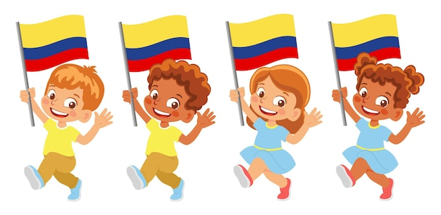 Флаг колумбии в руке. дети держат флаг. государственный флаг колумбии