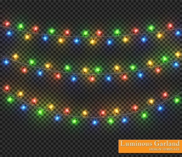 カラーガーランド、お祭りの装飾。透明な背景に分離された輝くクリスマスライト。
