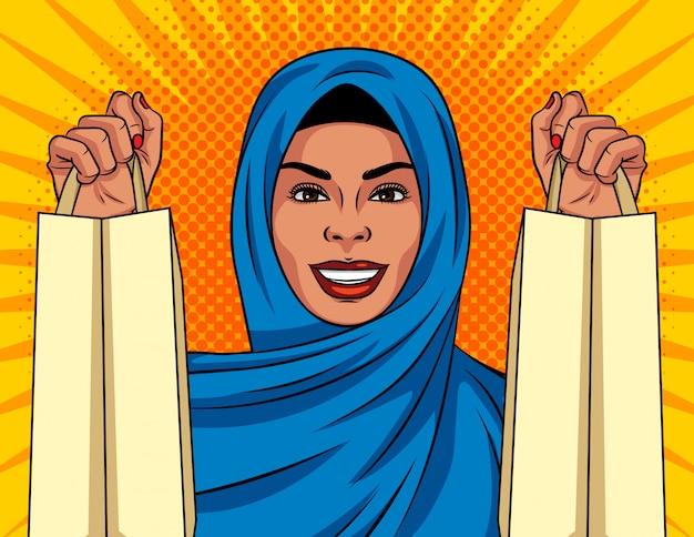 ポップなアートスタイルのカラーイラスト。ショッピングバッグで彼女の頭の上の伝統的なショールで美しいイスラム教徒の女性。